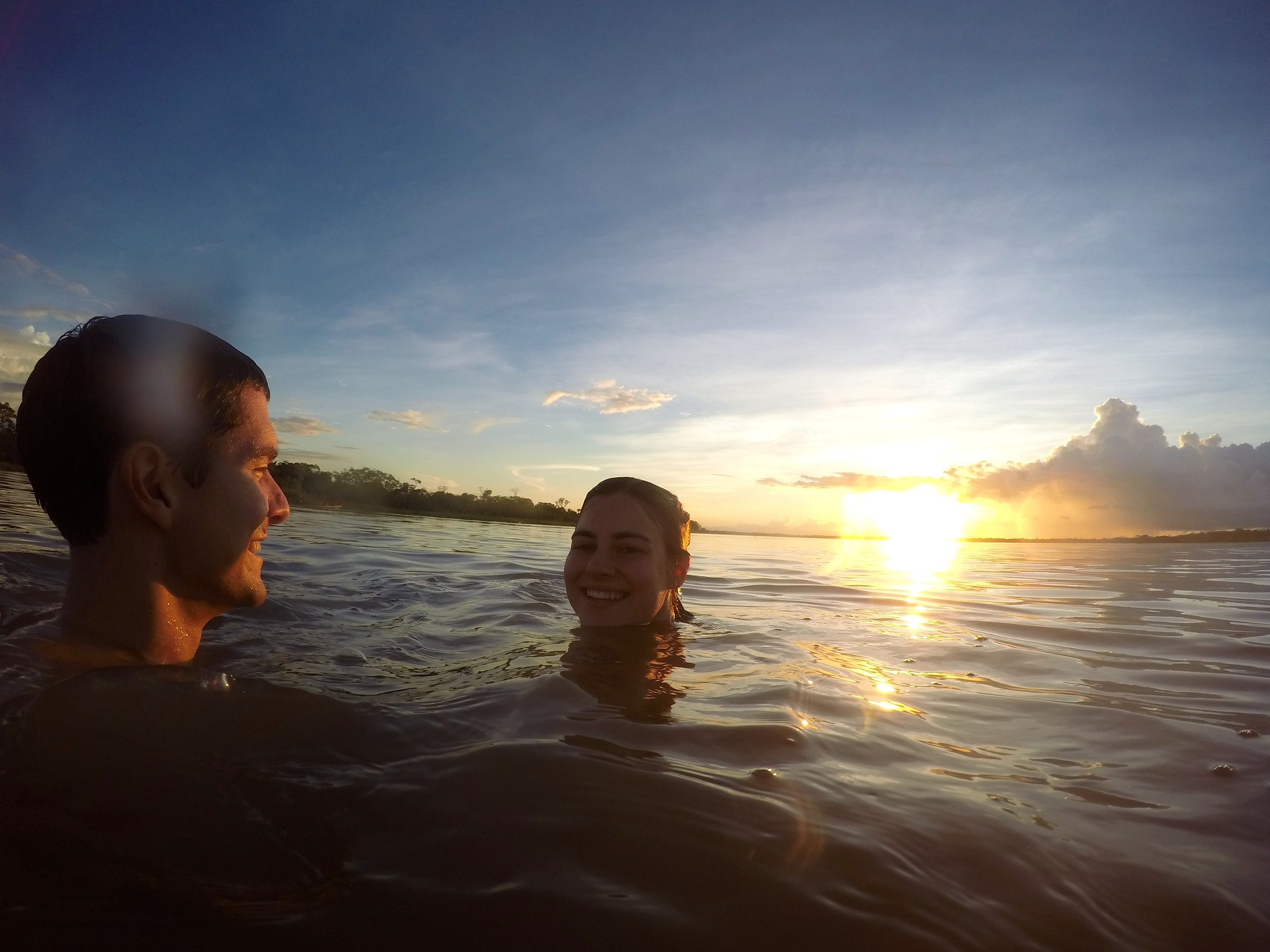 Swimming in the Amazon while the sun sets